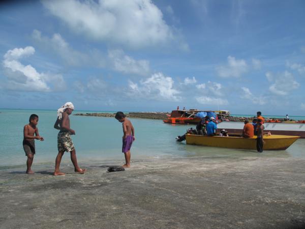 Kids fishing off the wharf
