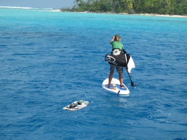 Paddling the kite gear ashore